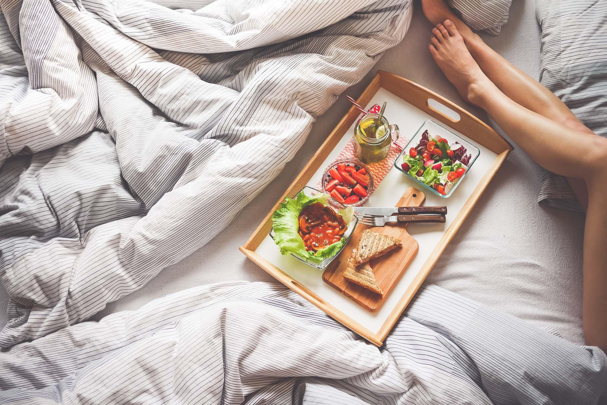 young-woman-enjoying-morning-breakfast-in-bed-picjumbo-com copy
